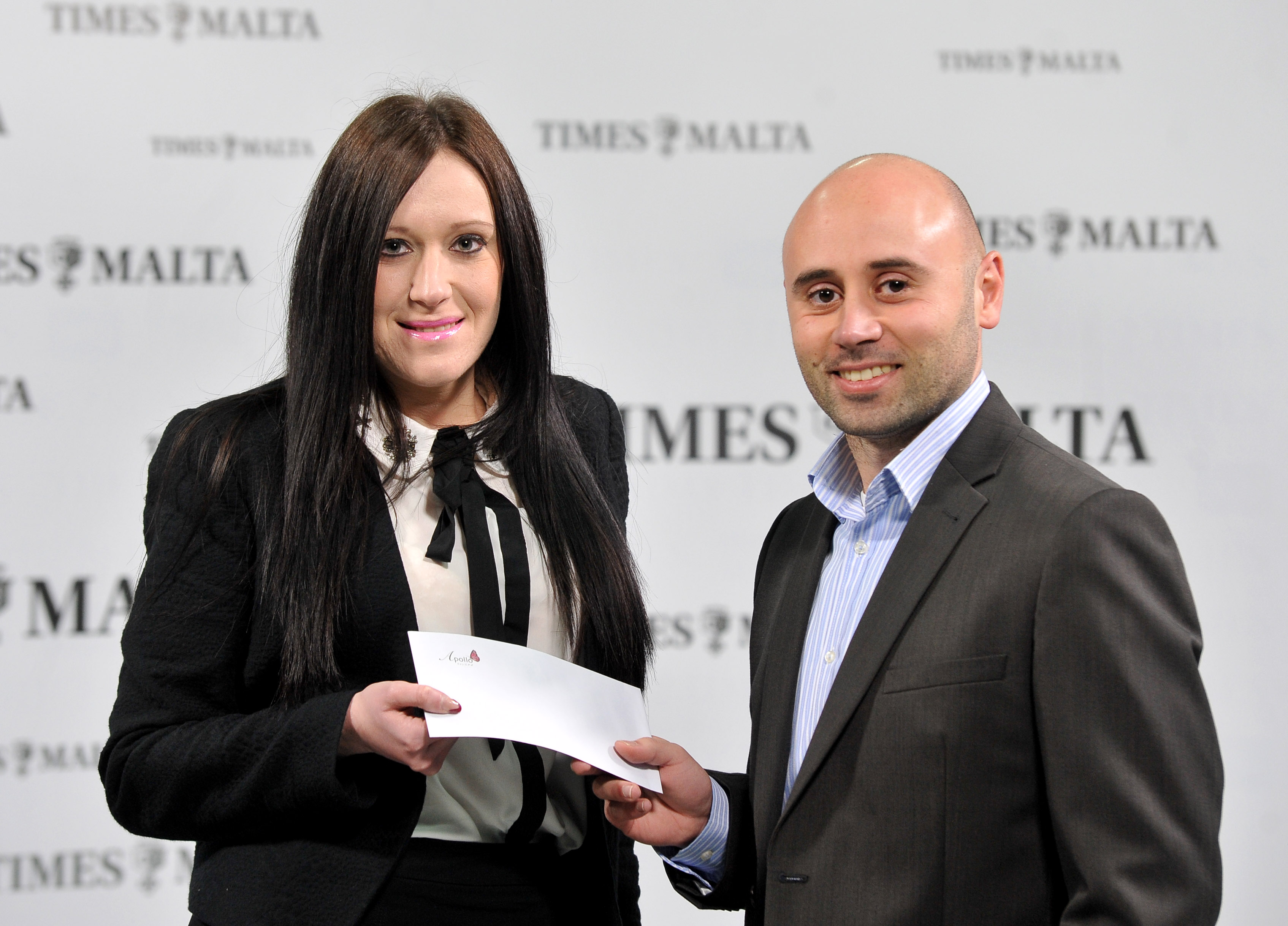 Times of Malta's CCO Alex Galea gives Sherise Atkins her voucher for treatments at the Apollo Spa