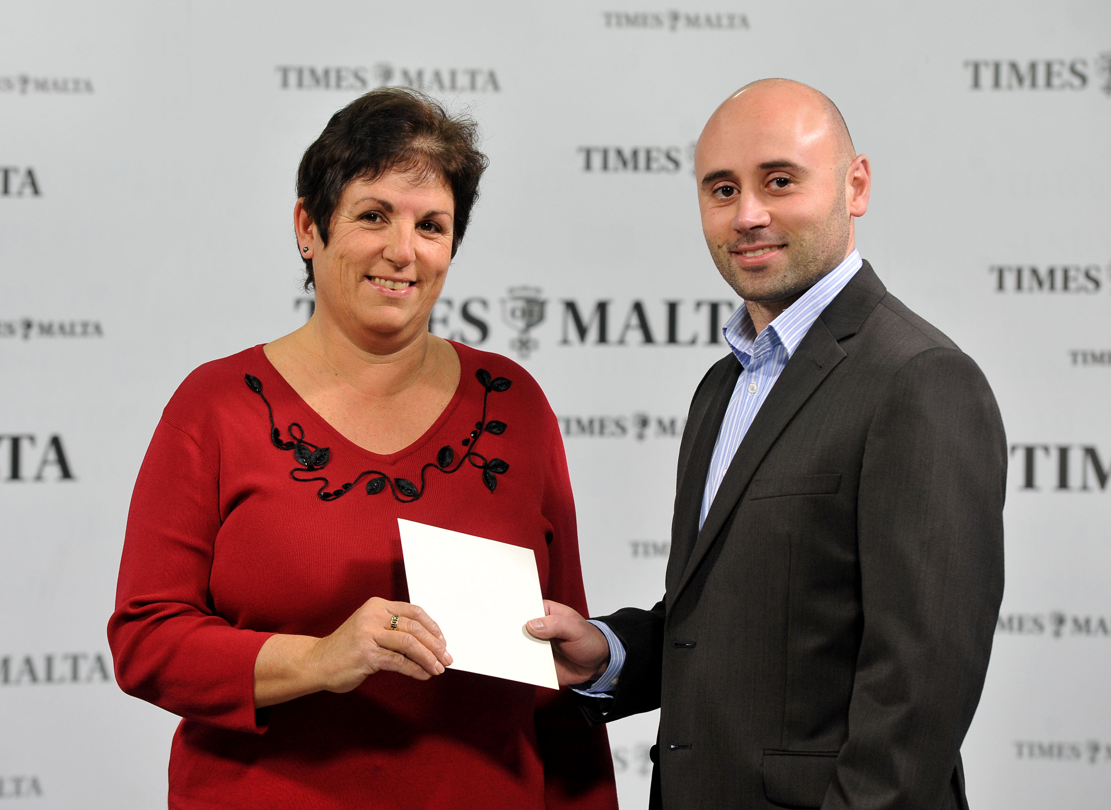 Josanne Peregin receives her voucher for lunch at Fra Martino from Times of Malta's CCO Alex Galea