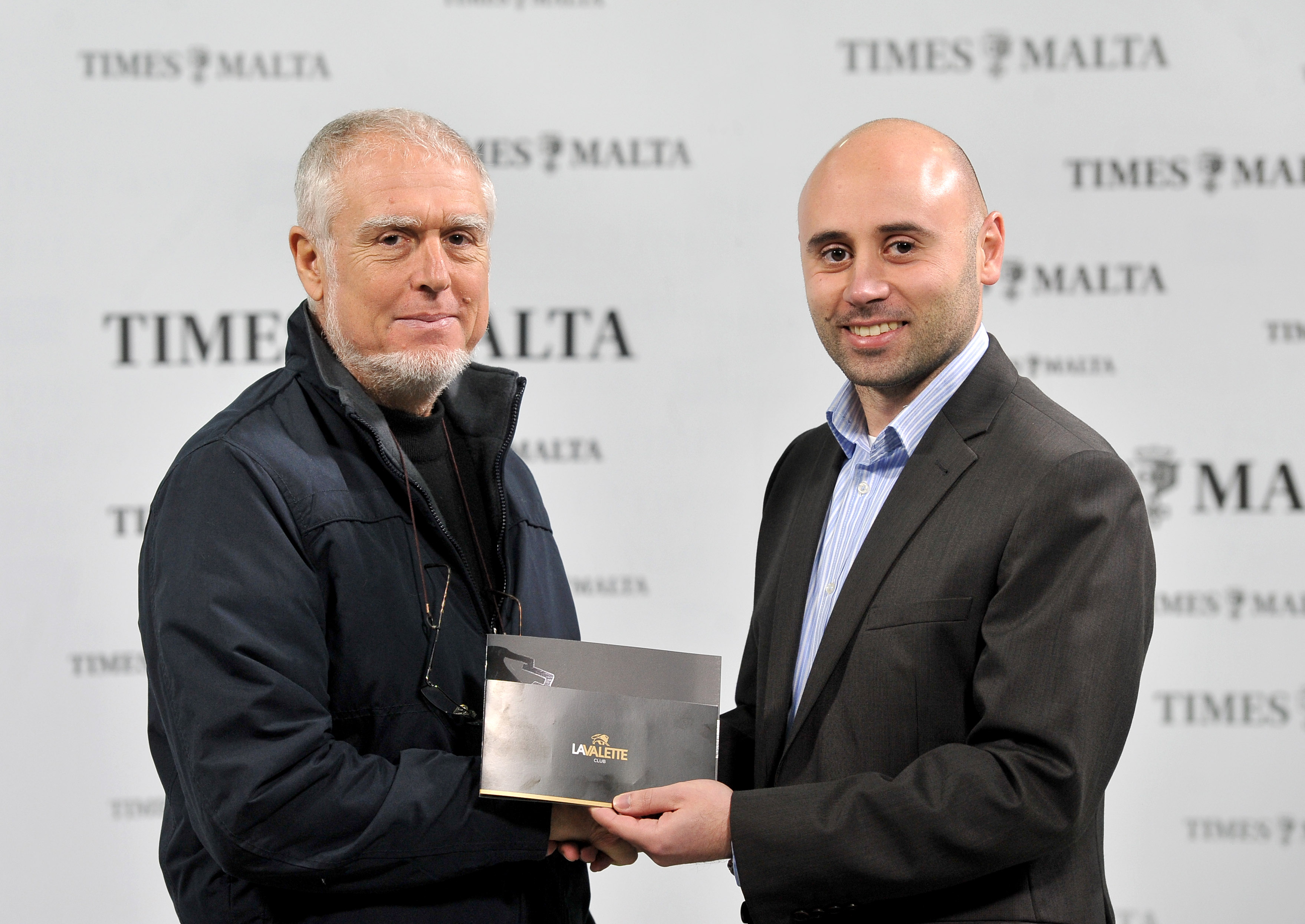 Joseph Muscat receives his membership to the La Valette Club from Times of Malta's CCO Alex Galea